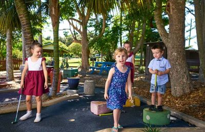 Children play mini golf at a birthday party celebration