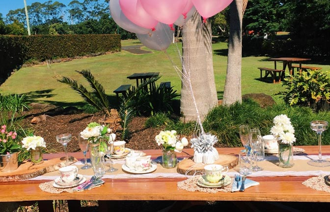 A table set for a wedding party in an outdoor courtyard