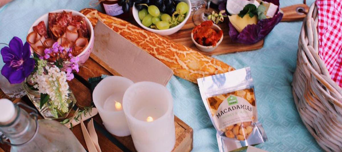 A gourmet picnic hamper and candles